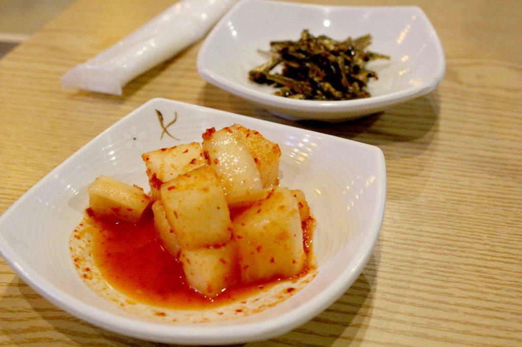 Kosamu appetizers: Daikon (winter radish) Kimchi and Myeolchi Bokkeum (fried anchovies)
