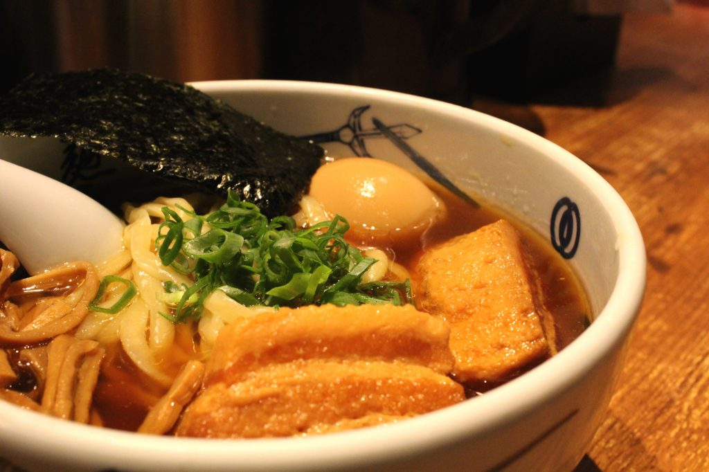 Menya Musashi - Ramen in a broth with tender pork, menma, nori, spring onions and egg.