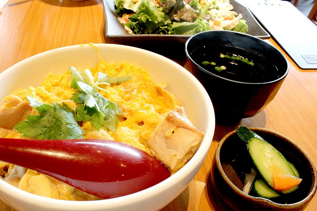 Odori Yakitori - Roast Oyako chicken and egg rice bowl with miso soup and cucumber.