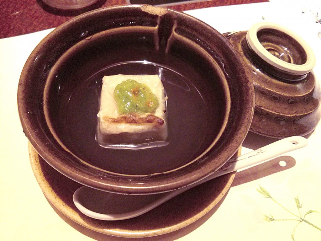 Yaki-minazuki-tofu (cooked red beans tofu with soy sauce and wasabi)