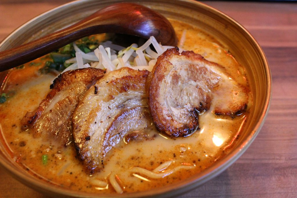 Yamato no Miso with gyoza - miso-based broth, with veggies, minced pork and spices, topped with three chased pork slices.