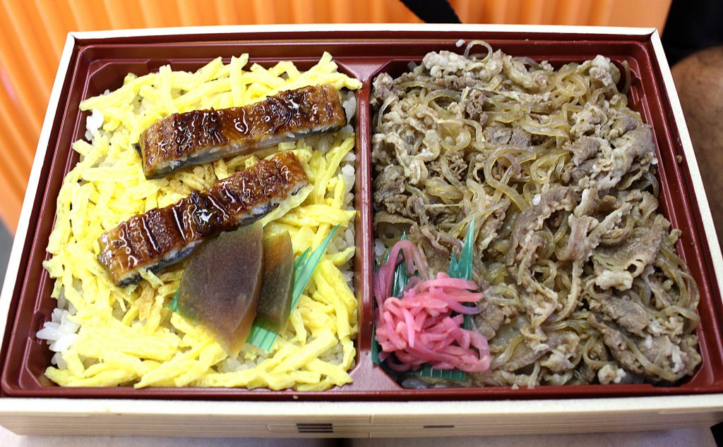 On the left: rice, omelette, pork. On the right: beef kebab with rice.