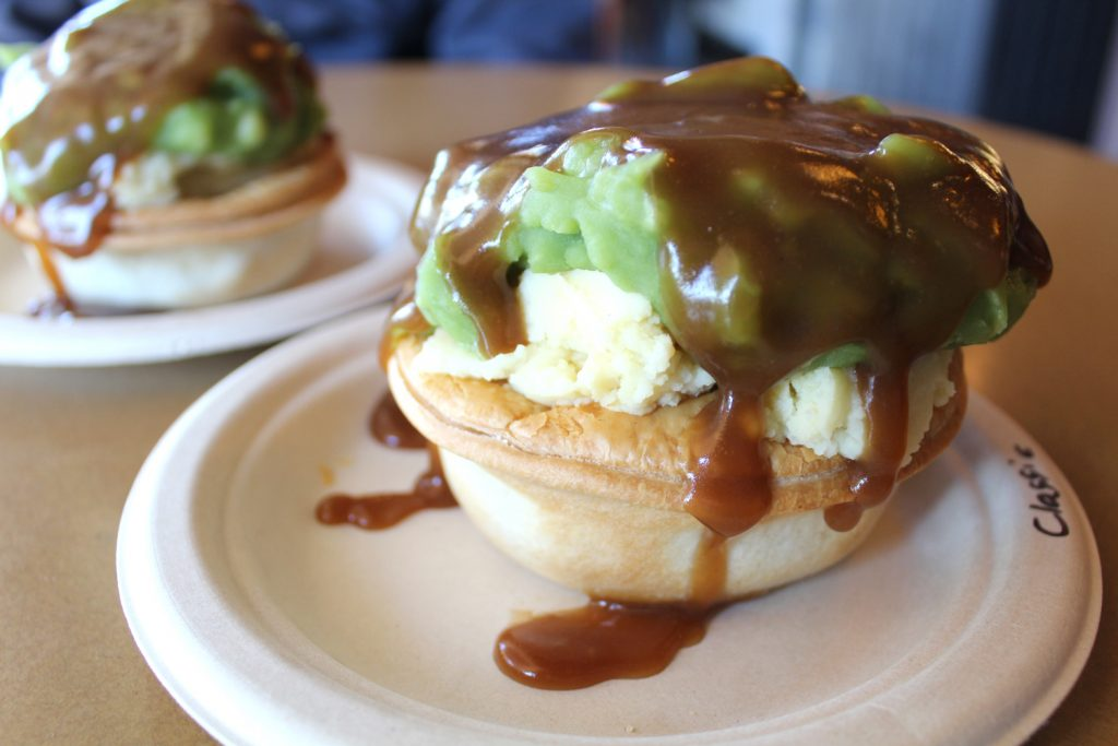 Classic beef + Steak, Bacon, and Cheese pies topped with mashed potatoes, mashed peas, and gravy.