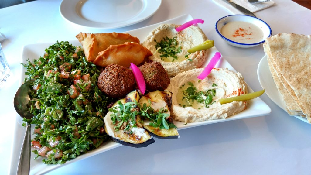 Vegetarian mixed platter: hommous, baba ganoush, tabouli, falafel, chargrilled eggplant, cheese sambousik and spinach triangle.
