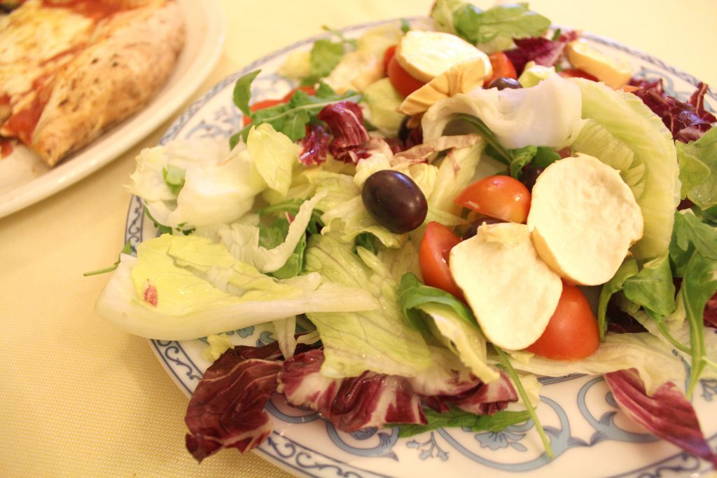 Vesuvio Salad - smoked buffalo mozzarella, cherry tomatoes, olives, and mixed leaves.