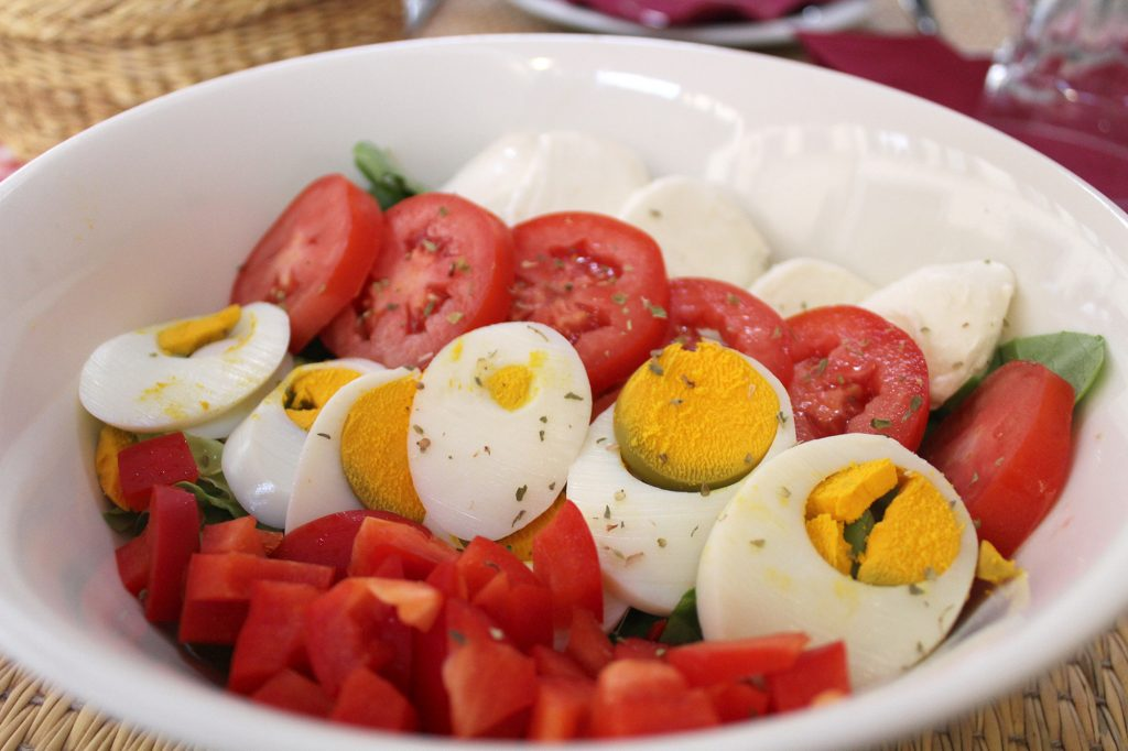 Casa Toscana salad - mixed leaves, fresh mozzarella, tomatoes, eggs, and red capsicum.