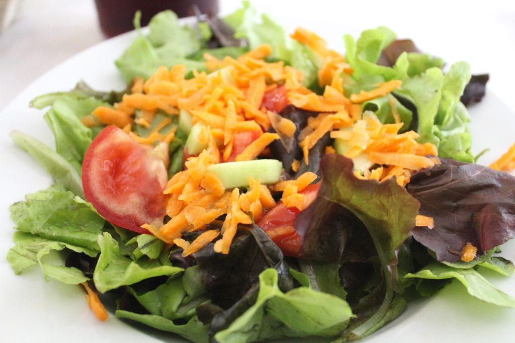 Simple salad - mixed leaves, tomato, and carrot.