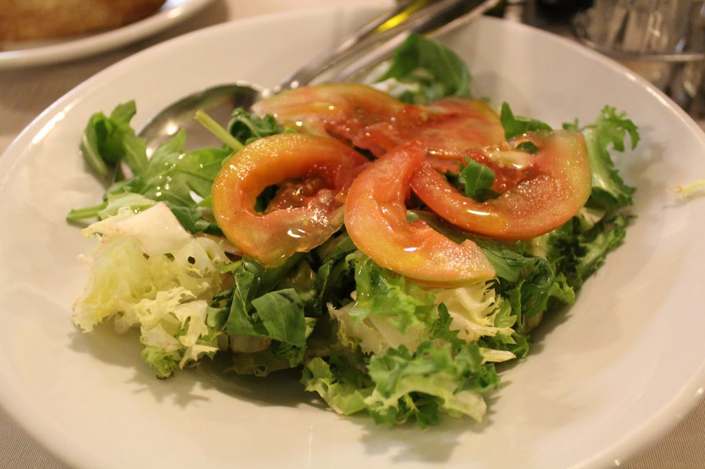 Simple salad - mixed leaves and tomato.