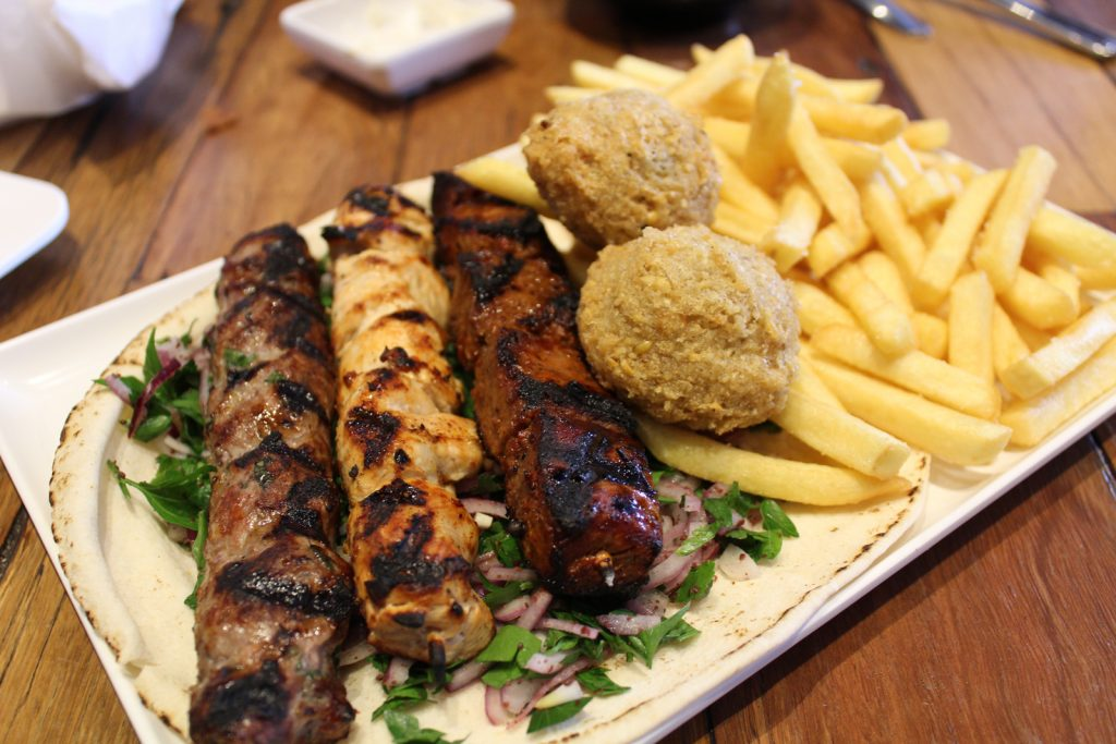 Mixed Grill Plate -skewers (1 kafta, 1 lamb, 1 chicken), 1 kibbeh, 2 falafels, and chips.