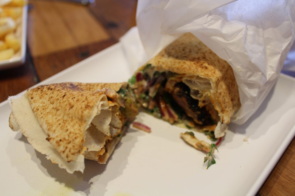 Lamb Grilled Wrap - Grilled premium lamb fillets wrapped in lebanese bread with hommus, onion/parsley, sumac, and pickles.