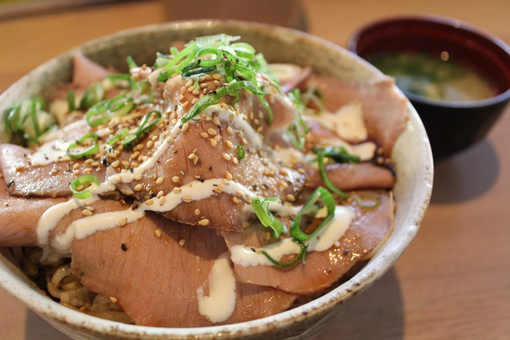 Roast Beef Donburi - A lot of thinly sliced roasted beef with homemade sauce, shallots, sesame on rice.