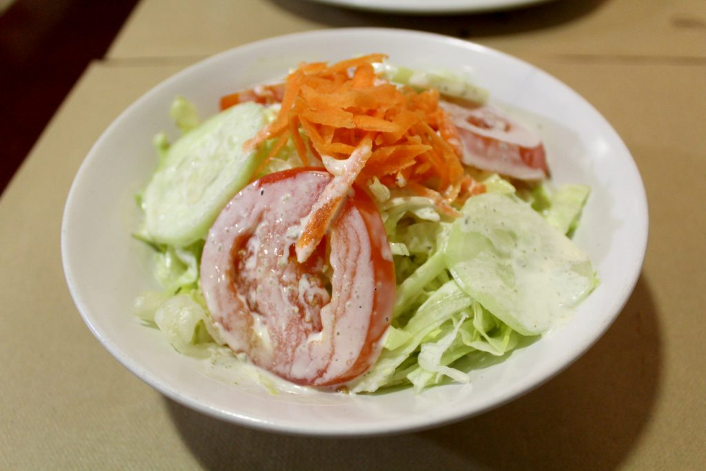 Simple salad - lettuce, tomatoes, cucumbers, and carrots.