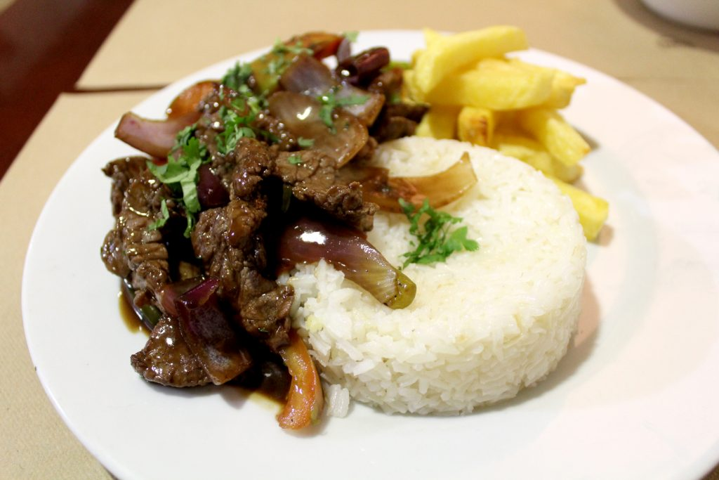 Lomo Salteado - Sautéed beef with vegetables, served with fires and rice.