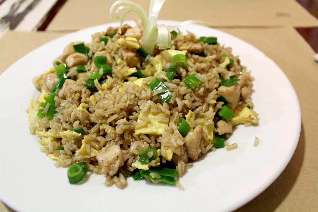 Arroz Chaufa - Rice mixed with chicken, eggs, and peruvian-chinese spices.