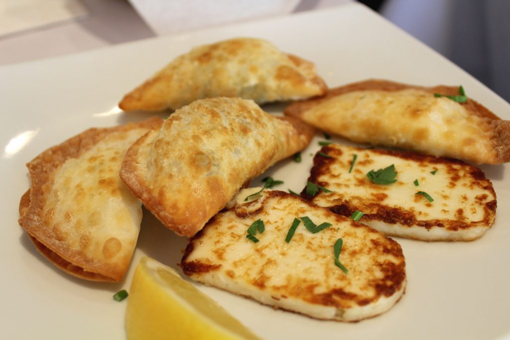Pan-fried halloumi cheese, spanakopita (spinach pie) and tyropita (pastry filled with cheese).
