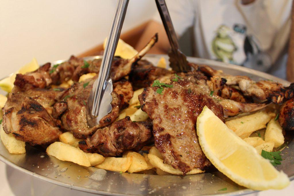 Souvlaki, lamb cutlets, pork chops, quails, loukanika (greek sausages), and hot chips.