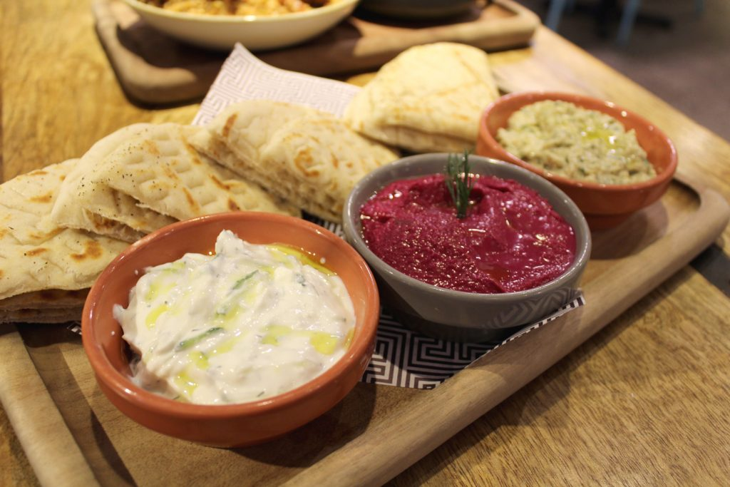 Dips: Tzatziki, Beetroot Hummus, and Smoky Eggplant with pita bread.