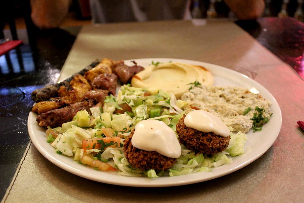 Combinat mixte - Assorted lamb, veal and chicken skewers with hummus, mutabal, fattoush and falafel.