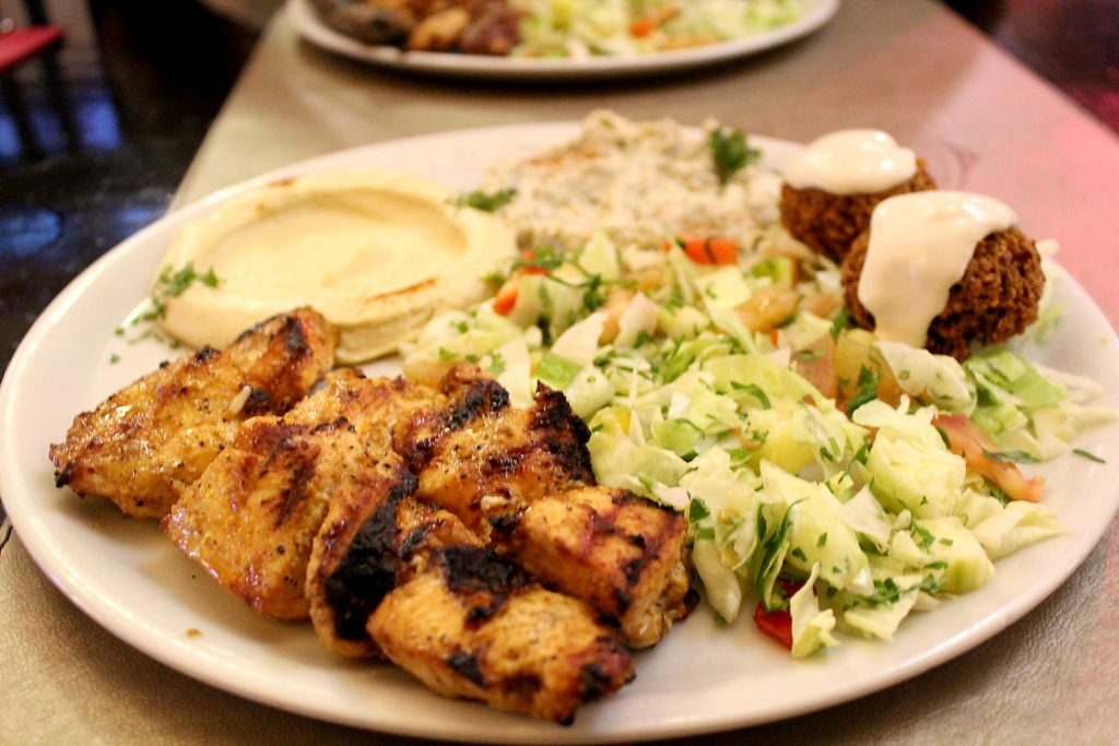 Combinat Shish Taouk - Chicken skewers with hummus, mutabal, fatthoush, and falaffel.