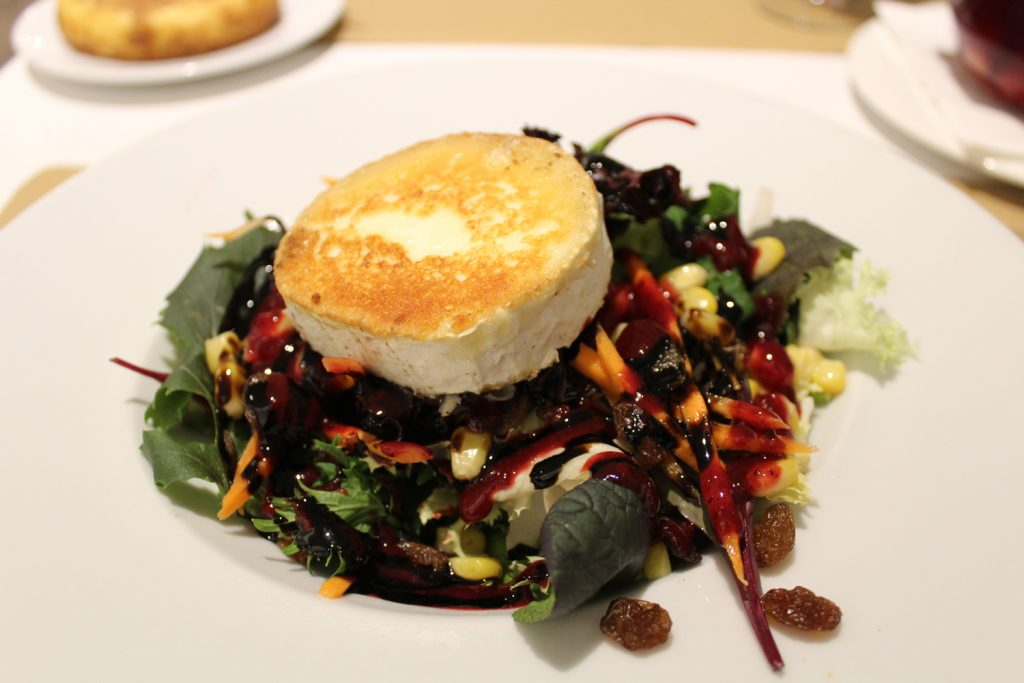 Goat's cheese salad - Mixed greens, walnuts, goat's cheese, and red berry vinaigrette.