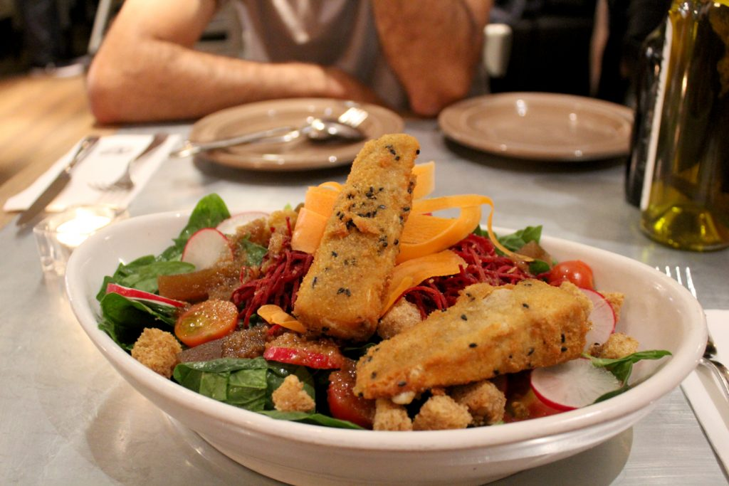 Spinach & Brie Salad - Spinach, croutons, pumpkin seeds, homemade quince, warm brie with a fig vinaigrette.