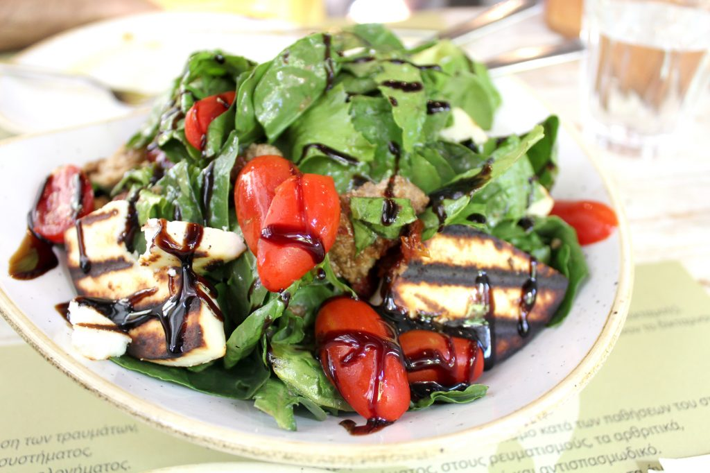 Green salad - with manouri cheese, sun dried tomato, rockets, lettuce, and balsamic dressing.