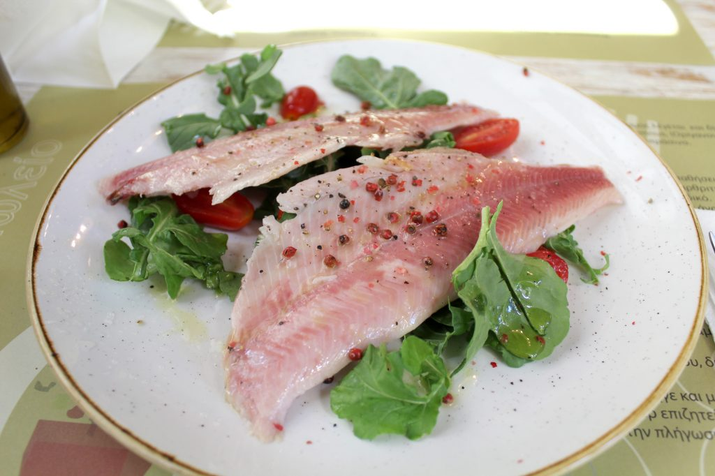 Smoked trout fillet, with rockets, fresh peppers, and cherry tomatoes.