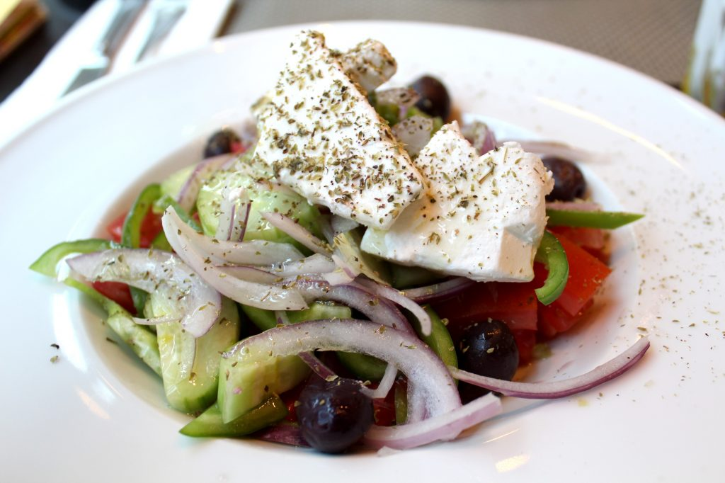 Greek salad - Tomato, cucumber, olives, capsicum, onion, feta cheese & capers.