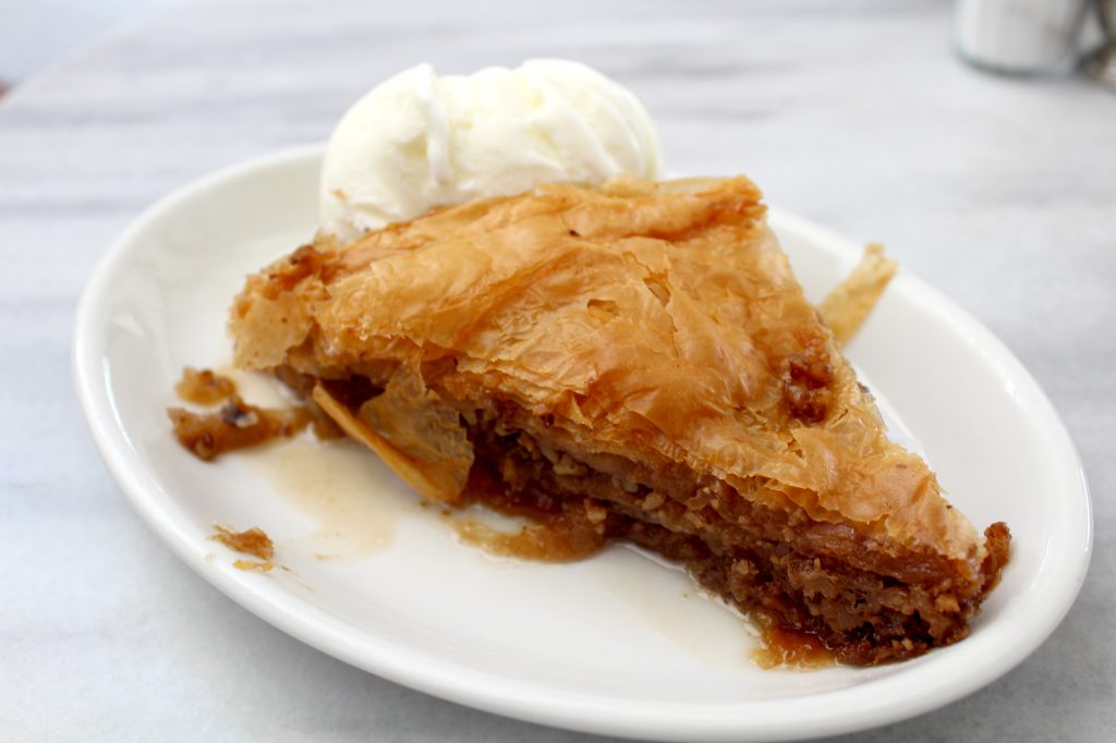 Baklava - layers of filo pastry, filled with chopped nuts and syrup. Served with vanilla ice cream.